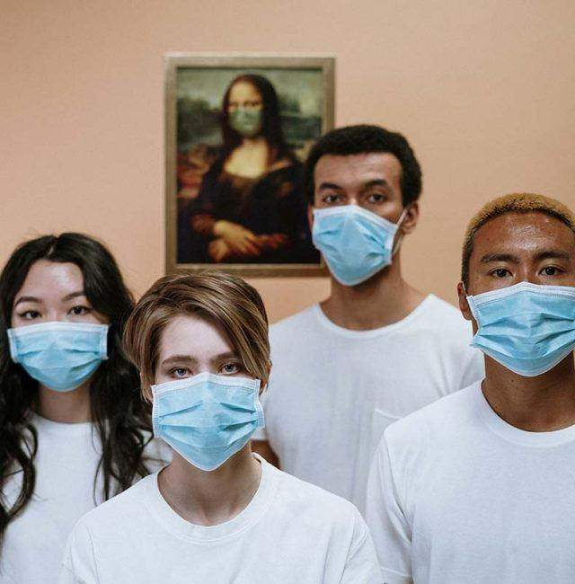 a diverse group of young medial professionals wearing face masks